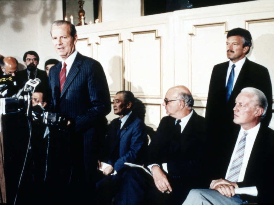 In 1985, David Mulford, far right, watches James Baker announce the Plaza agreement.jpg